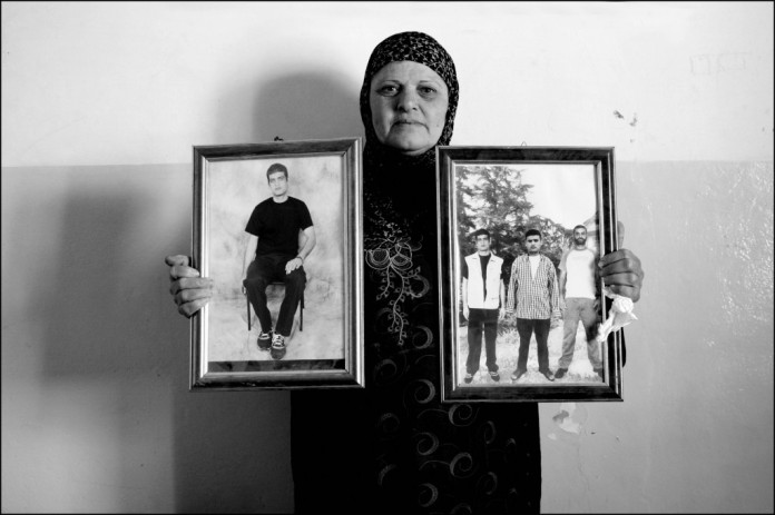 Fatima-Kamel-holding-her-imprisoned-sons-pictures-1024x682