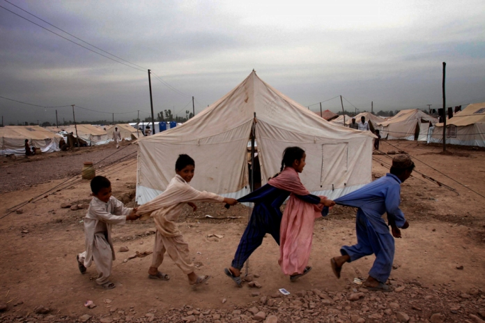 "Refugee children from Pakistan's troubled Swat Valley who fled fighting, play in Jalozai camp, Monday, May 18, 2009 in Peshawar, Pakistan. The Pakistani Taliban have vowed to resist until the ""last breath"" as security forces entered two militant-held towns and fought on the outskirts of a third in what could turn into bloody urban battles near the Afghan border. (AP Photo/ Mohammad Sajjad)"