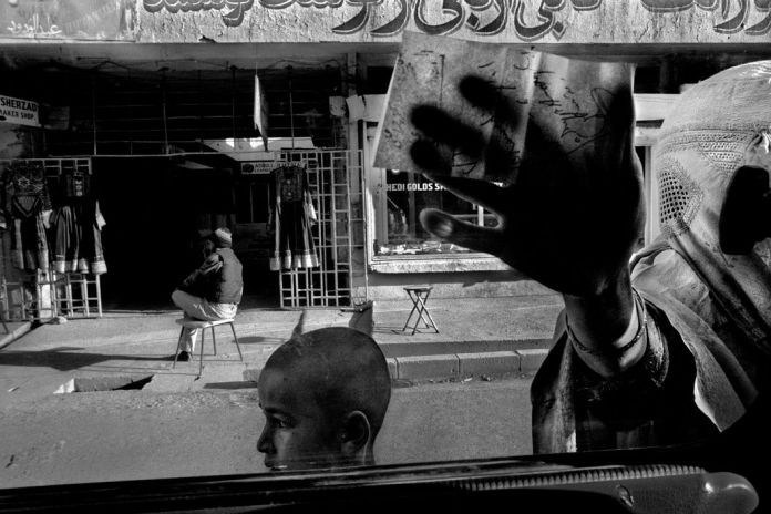 AFGHANISTAN. Kabul. Chicken street. The woman showing me a drug prescription. 2001.