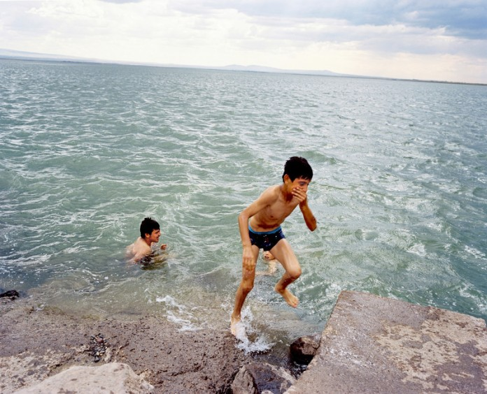 Kids playing in the Devegeçidi reservoir dam. The Dam is one of the 22 dams of the Southeastern Anatolia Project of Turkey. It is near Diyarbak?r on a branch of the Tigris river. Turkey