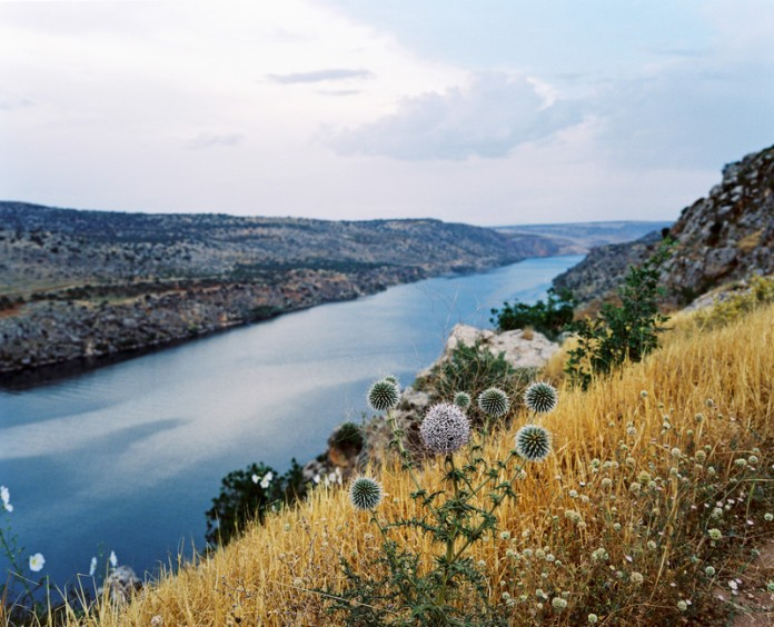 View on the reservoir lake of the Birecik Dam on the Euphrates river. As part of the Southeastern Anatolia Project, aka GAP, several dams were constructed in the area and surrounding regions as part of a larger agricultural and economic initiative by the Turkish Government. Turkey