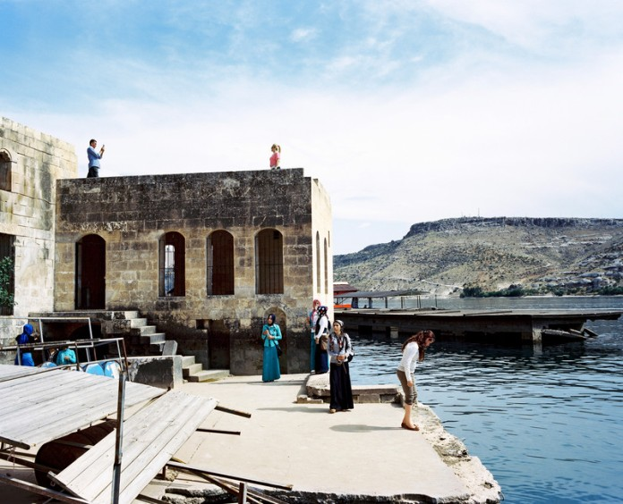 Local tourists visiting the village of Halfeti partly flooded by the reservoir lake of the Birecik Dam on the Euphrates river.The dam was built on top of the ruins of the ancient city of Zeugma. The inhabitants of Halfeti and Savaçan were displaced to the city of Karaotlak (also called New Halfeti) built by the Housing Development Administration of Turkey. Halfeti,Turkey Halfeti, Turkey