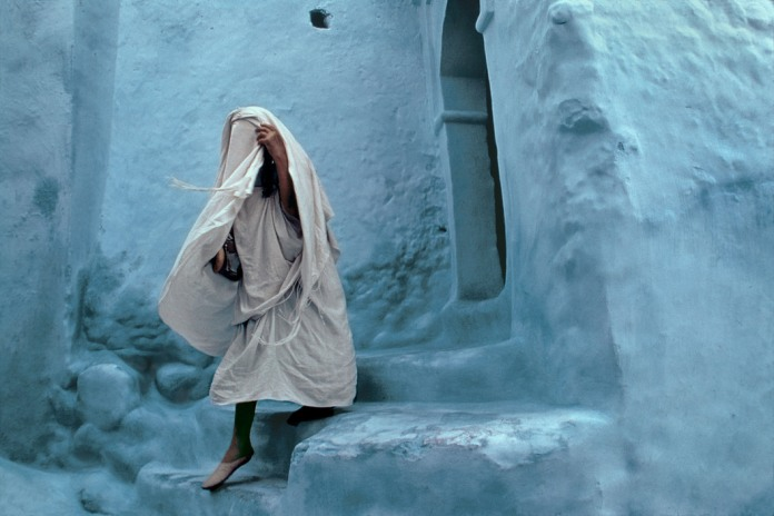MOROCCO. Rif. Chechaouen. 1987. Street life in the Rif mountains. Walls are often painted in blue and white.
